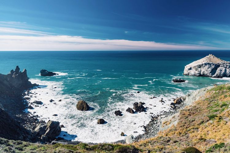 Sea Water Sky Scenics - Nature Rock Horizon Over Water Horizon Beauty In Nature Rock - Object Solid Tranquil Scene Land Nature Tranquility Blue Beach Cloud - Sky Rock Formation Idyllic No People Outdoors Rocky Coastline