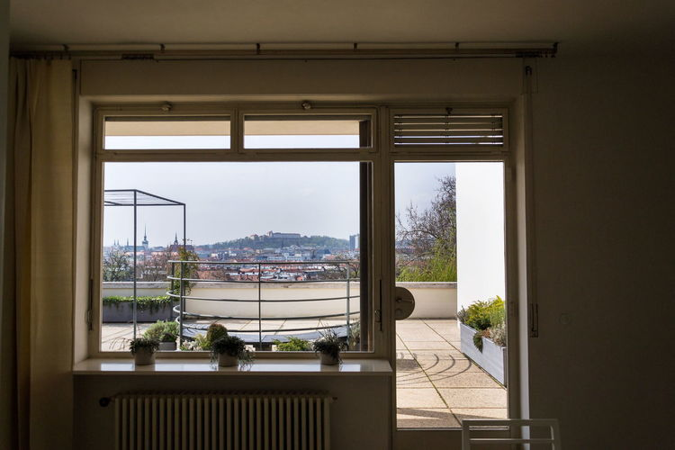 Sea seen through glass window at home