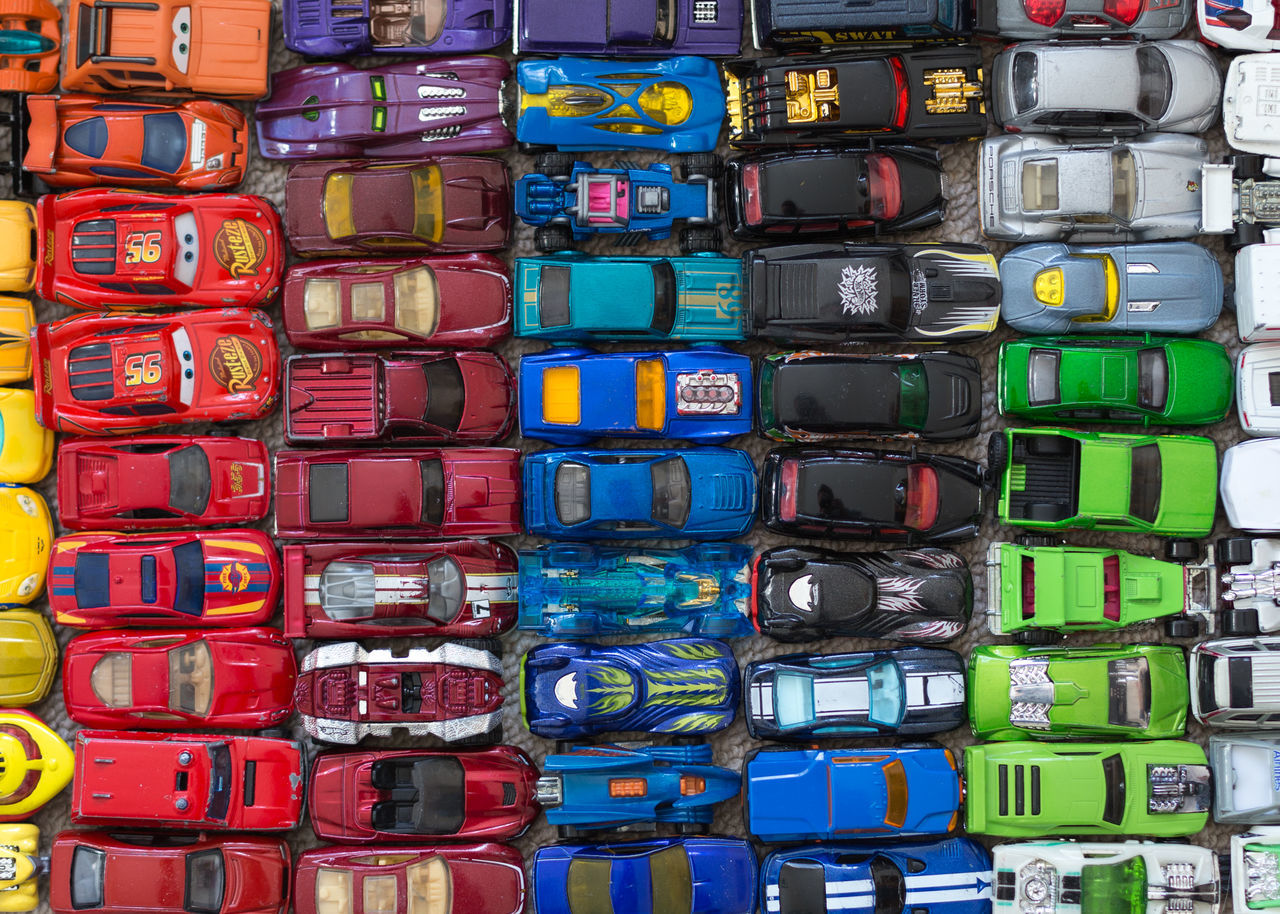 Full frame shot of colorful toy cars arranged for sale