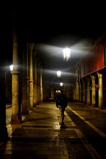 Architectural Column Travel Destinations One Person Lighting Equipment One Man Only Built Structure Night Illuminated People Architecture Indoors  Full Length Atmosphere Colorful Architecture Silhouettephotography Silhouette Streetphotography People Walking  People Photography Building Exterior The Street Photographer - 2017 EyeEm Awards