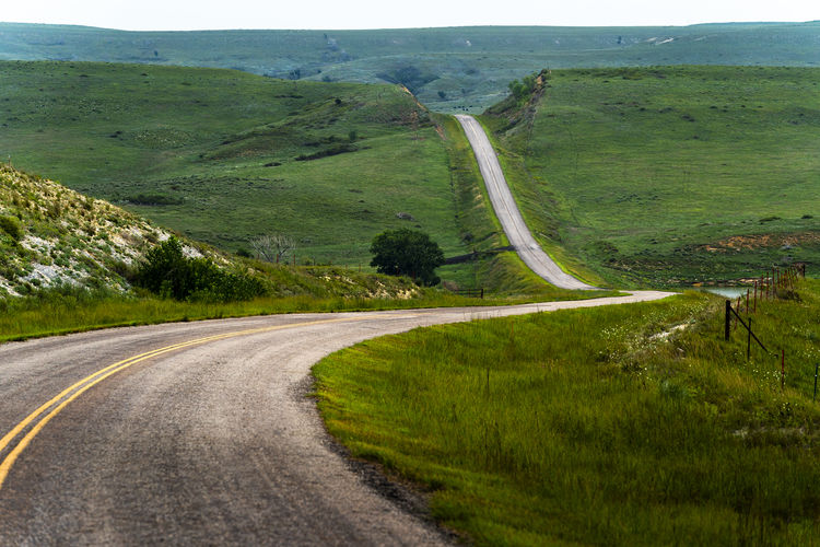 Another photo from recent trip to Lake Wilson in central Kansas. The Kansas Prairies can be striking. Kansas Landscape Wilson Lake, Ks Kansas Prairie Landscape Road Shot With Sony A9 Sony A9 Sonyalpha Winding Road
