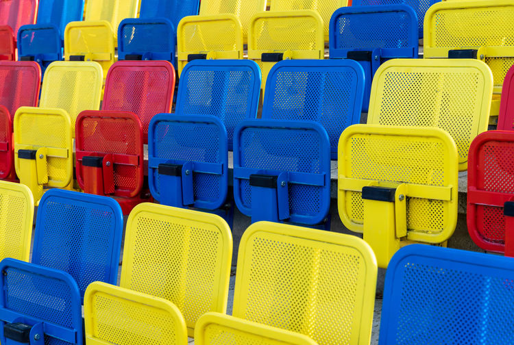 Stadium In A Row Sport Soccer Football Stadium Backgrounds Full Frame Blue Multi Colored Side By Side No People Chair Repetition Seat Large Group Of Objects Yellow Arrangement Plastic Order Choice Day Group Of Objects Empty Foldable Turquoise Colored