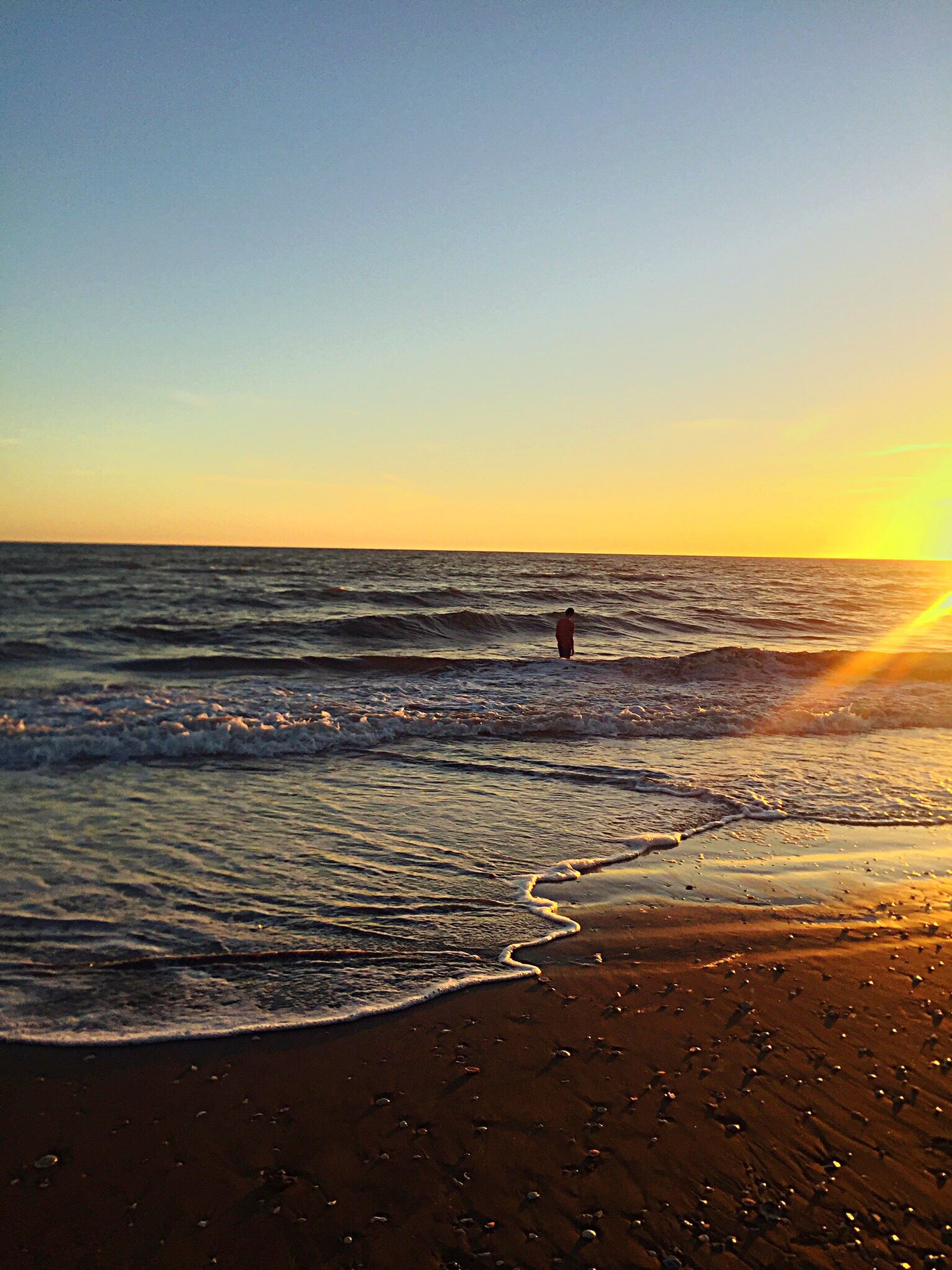 sea, beach, horizon over water, water, shore, sunset, sand, scenics, tranquil scene, beauty in nature, tranquility, wave, clear sky, nature, orange color, idyllic, copy space, sky, sun, coastline