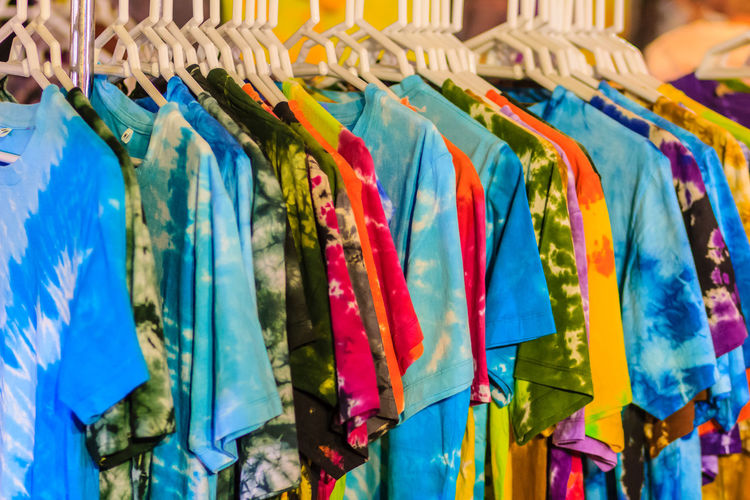 Clothes hanging on rack for sale
