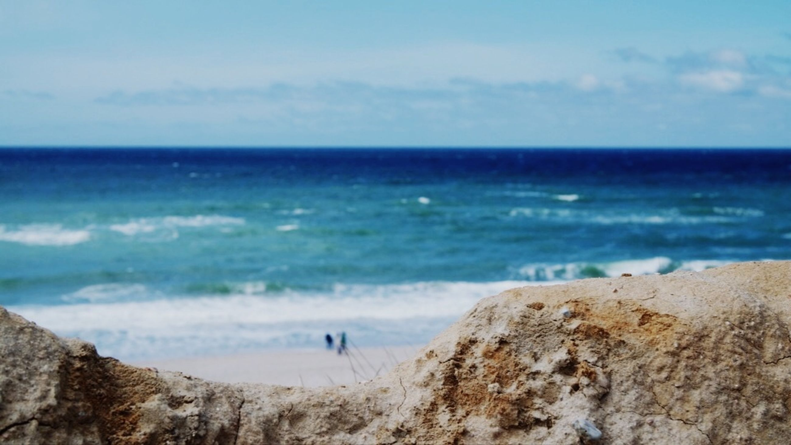 sea, water, beach, land, horizon, horizon over water, beauty in nature, scenics - nature, motion, sky, wave, nature, tranquil scene, tranquility, rock, sand, aquatic sport, day, rock - object, no people, outdoors