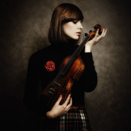Adult Artist Arts Culture And Entertainment Beautiful Woman Beauty Bow - Musical Equipment Hairstyle Holding Indoors  Music Musical Instrument Musician One Person Skill  Standing String Instrument Studio Shot Violin Violinist Women Young Adult Young Women