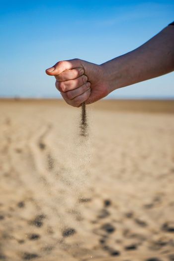 Hand sand timer Beach Sand Hand Timer Sand Timer Shore Shoreline Seaside Sandy Beach Girls Hand Human Hand Sand Dune Water Releasing Beach Sand Desert Motion Sky
