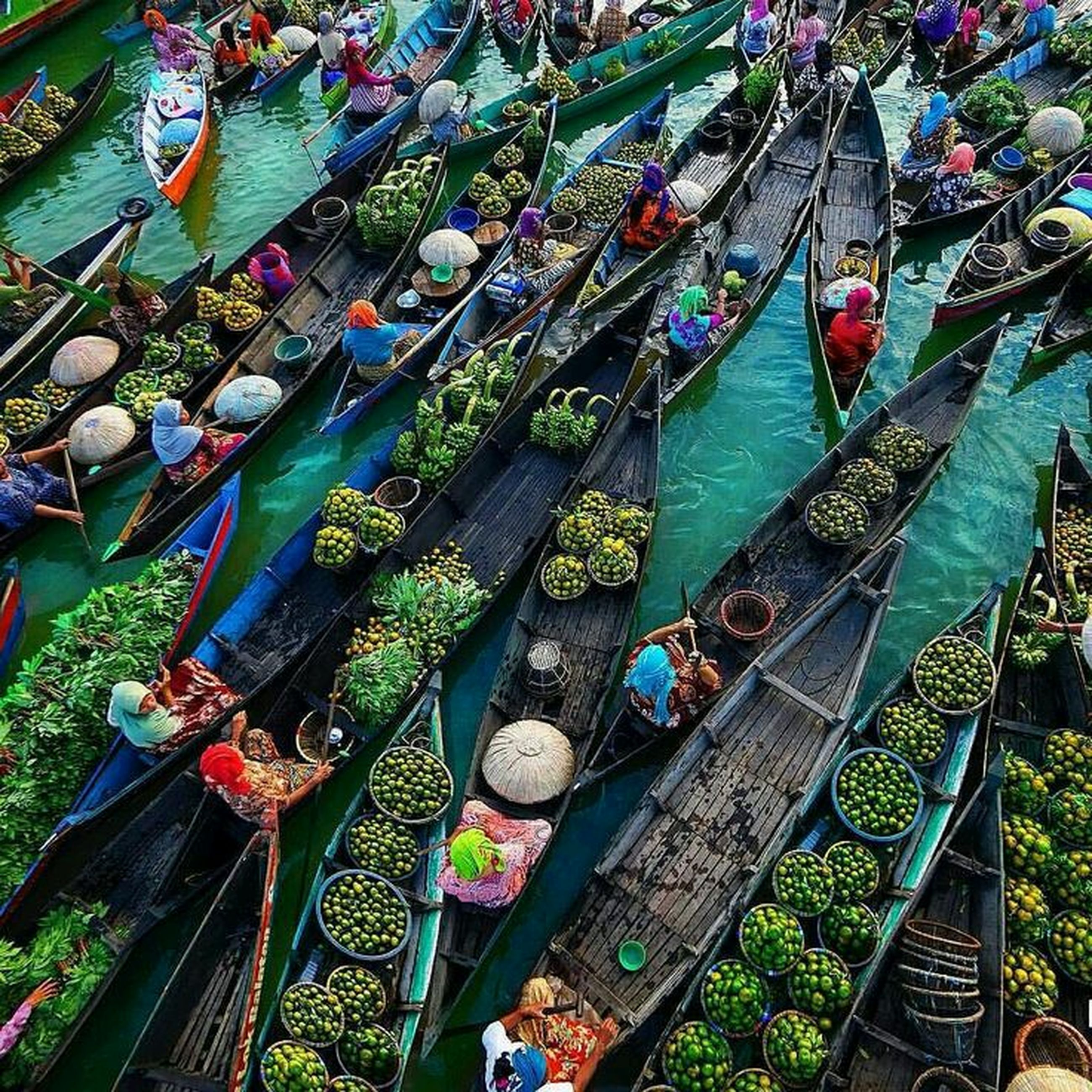 abundance, large group of objects, high angle view, for sale, market, variation, retail, choice, day, outdoors, market stall, in a row, sunlight, green color, arrangement, incidental people, hanging, nature, order