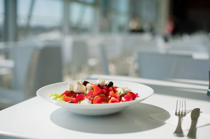 Fruits in plate on table