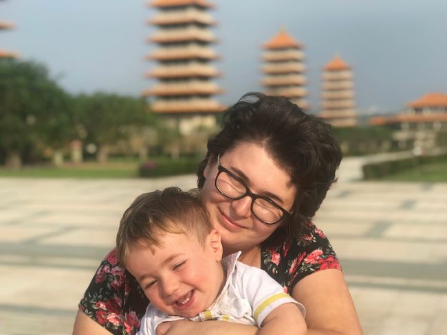 EyeEm Selects Buddha Memorial Center Foguangshan Kaoshiung Taiwan Family With One Child Togetherness Real People Mother Love Focus On Foreground Bonding Outdoors Childhood Smiling Lifestyles Happiness Building Exterior Day Child Young Adult City Close-up Adult People