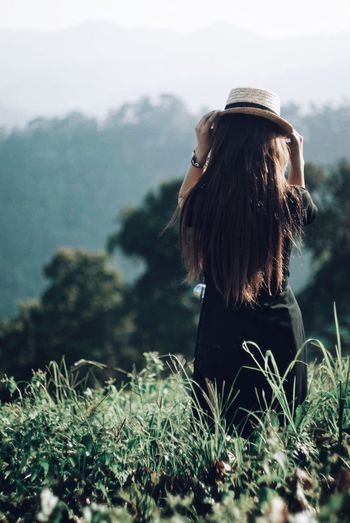 EyeEm Selects One Person Real People Hairstyle Leisure Activity Hair Long Hair Lifestyles Women Rear View Nature Adult Day Plant Standing Beauty In Nature Land Mountain Outdoors Young Women