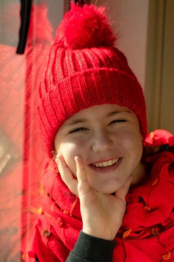 Portrait of happy girl in red hat