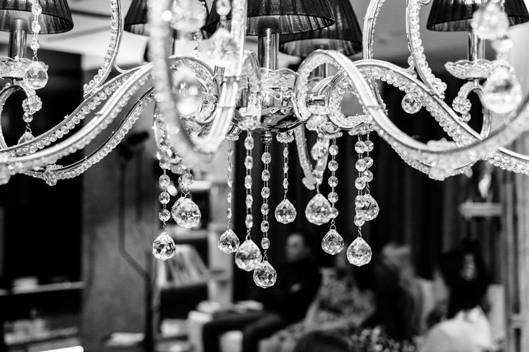 Close-up of chandelier hanging in store