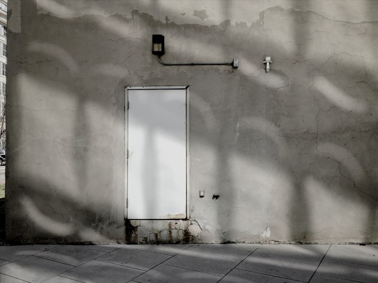 Concrete wall with closed door