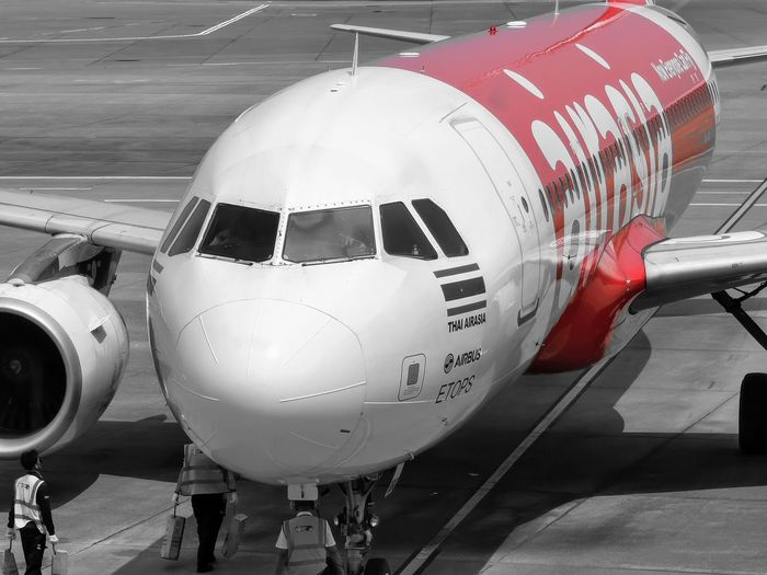 Close-up of airplane at airport runway