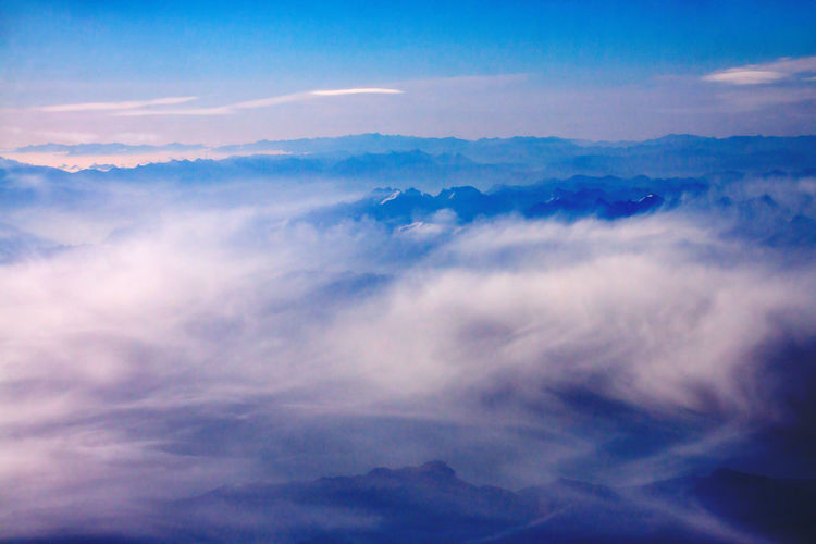 Cloud - Sky Beauty In Nature Scenics - Nature Sky Tranquil Scene Tranquility Nature No People Idyllic Cloudscape Blue Environment Backgrounds Outdoors Low Angle View Day Majestic Aerial View Softness Above Mountain Range Peaks Mountains