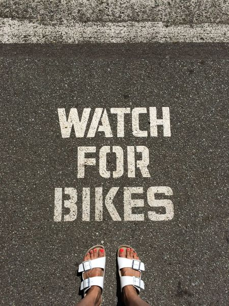 Biking Around Birkenstock Sign Signage Signs Stanley Park Typography Vancouver Bikes Bikeswithoutlimits Close-up Communication Graphic Design High Angle View Human Body Part Human Foot Outdoor Sign Outdoors Standing Standing Alone Tarmac Text Vancouver BC Watch For Bikes