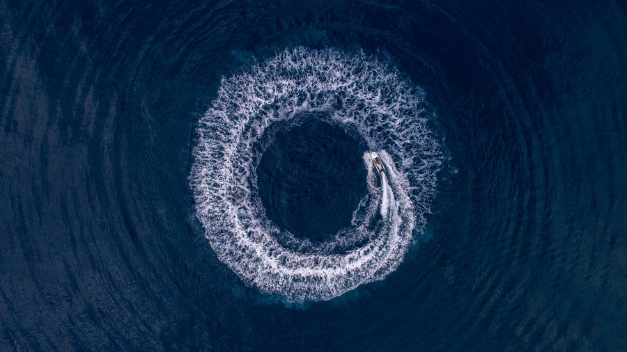High angle view of blue sea seen through hole