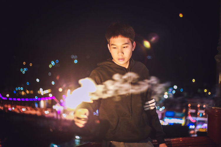 Nightportrait Loykrathong Festival Colors Smoke Light In The Darkness Human Hand Cyberspace Smiling Defocused Wireless Technology Men Child Reunion - Social Gathering Happiness Multi Colored The Modern Professional