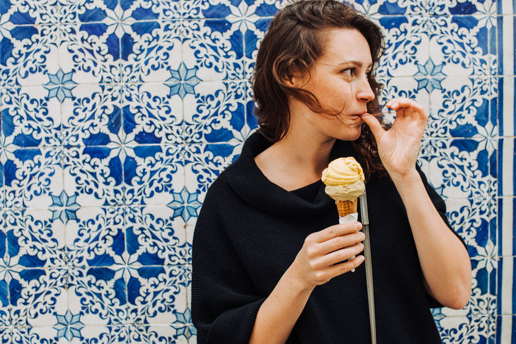 Midsection of woman eating ice cream
