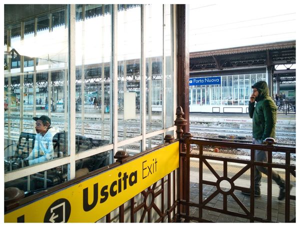 Waiting hall in Brescia station on platform Boy Walking Platform Of Train Station Waiting Hall Real People Glass - Material Transparent Built Structure Window