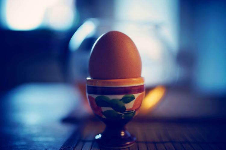 Close-Up Of Brown Egg In Cup On Table
