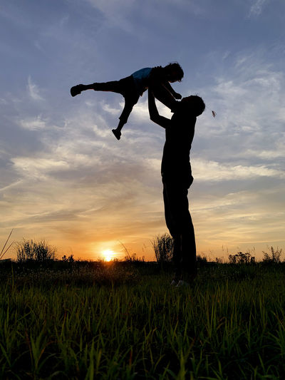 Man Father Child Son Family Dad Silhouette People Kid Boy Carrying Carry Lift Happy Parent Together Lifestyle Fun Young Holiday Sunset Vacation Outdoor Male Daddy Healthy Leisure Summer Joy Love Day Freedom person Nature Travel Active Couple Sunrise Little Childhood