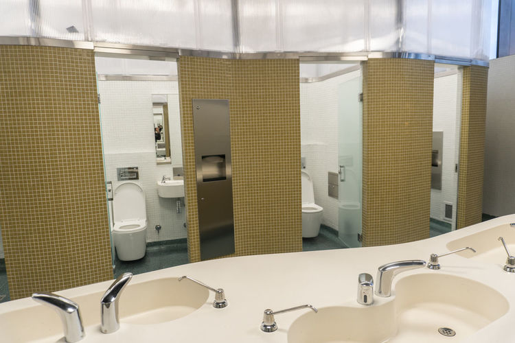 Indoors  Bathroom Healthcare And Medicine No People Domestic Bathroom Household Equipment Absence Sink Mirror Hygiene Faucet Technology Tile Flooring Medical Equipment Domestic Room Public Restroom In A Row Hospital Machinery Clean