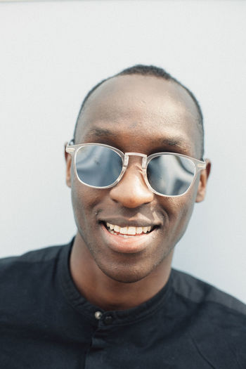 Portrait of serene young man with mirrored sunglasses