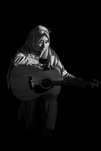 Blackandwhite Portrait Girl Shadows & Lights Sunlight And Shadow Hijab Black And White Musician Plucking An Instrument Black Background Musical Instrument Guitar Classical Music Music Women Sitting Arts Culture And Entertainment Guitarist Classical Guitar Acoustic Guitar Acoustic Music EyeEmNewHere Modern Hospitality The Fashion Photographer - 2018 EyeEm Awards