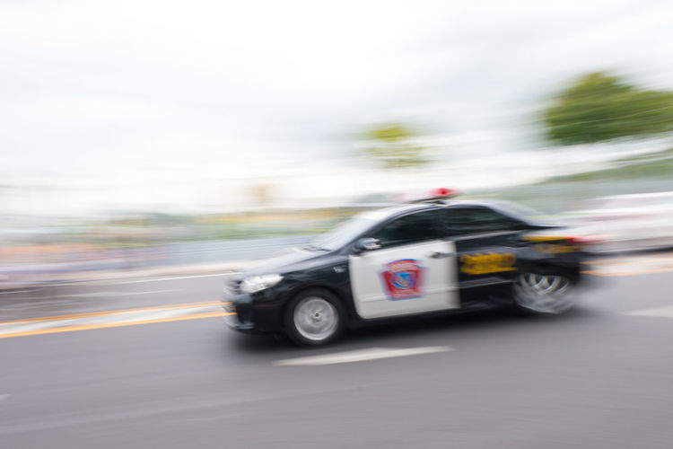 Blurred motion of car moving on road