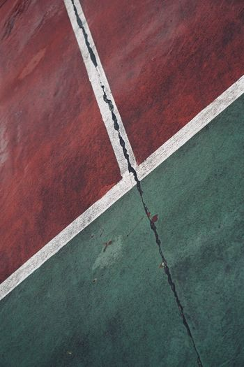 Old abandoned tennis cout in the street