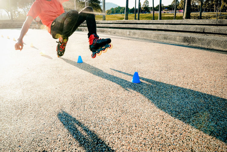 Real People Sport Lifestyles Men Day Nature Sunlight Low Section People Shadow Leisure Activity Human Leg Human Body Part Exercising Outdoors Motion Running Body Part Healthy Lifestyle Roller Skate Accident Safety Recreational  Youth