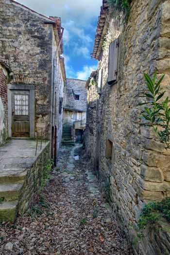 Narrow alley amidst old buildings in town