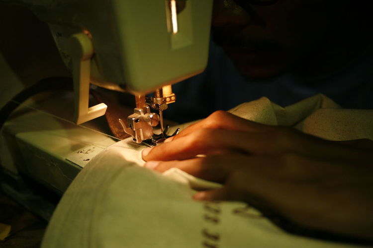 Human Hand Human Body Part Hand Sewing Machine Sewing One Person Machinery Real People Occupation Skill  Textile Art And Craft Selective Focus Indoors  Industry Working Body Part Tailor Sewing Needle Design Professional Manufacturing Equipment Finger Equipment Small Business