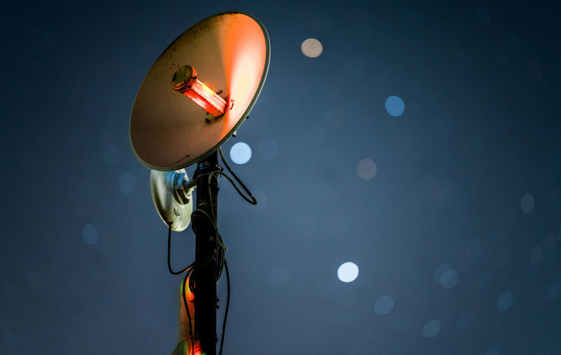 Low angle view of satellite dish against sky at night