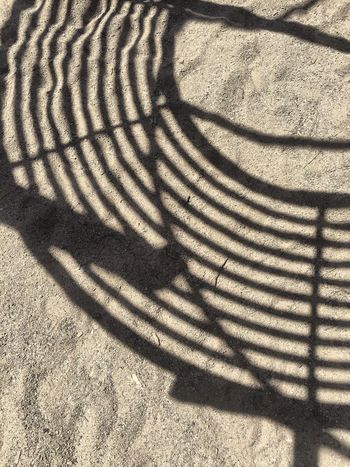 Shadow Sunlight High Angle View Day Focus On Shadow Outdoors Pattern No People Nature Playground Sand Shadows & Lights Patterns Simplicity Lines Detail Eye4photography  Sandpoint Idaho Zen Miksang Yinyang IPhoneography EyeEm Gallery
