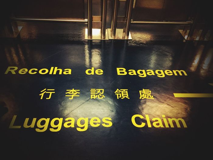 Bem-vindo a Macau Macao  Macao Photos Ferry Terminal Portuguese Chinese English Colonial Leftovers Language Signs IPhoneography Business Trip Not Seeing Much Recolha De Bagagem Multilingual Disembarking