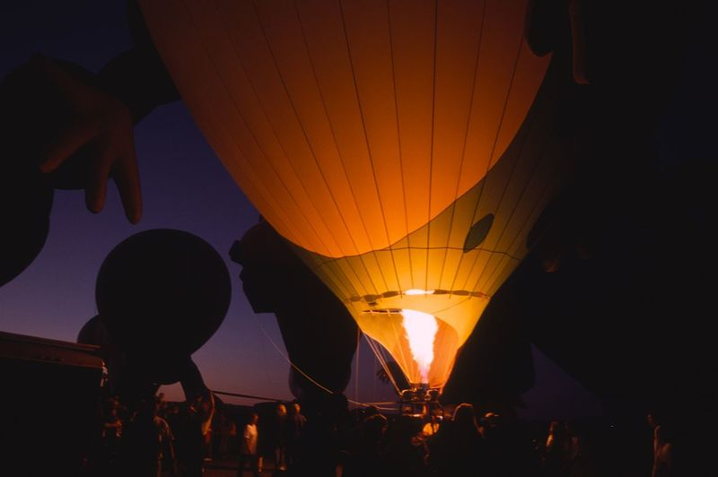 People in hot air balloon at night