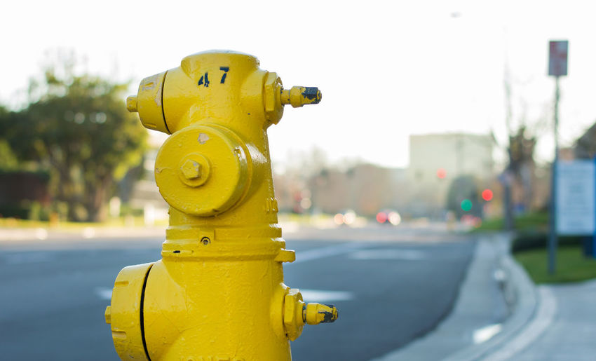 yellow fire hydrant Emergency Horizontal Hydrant Street Light USA City Clear Sky Close-up Danger Day Fire Hydrant Focus On Foreground Line, Pipe, Smoke, Heat, Warm No People Outdoors Sky Street Streetphotography Urban Water Hydrant Yellow First Eyeem Photo