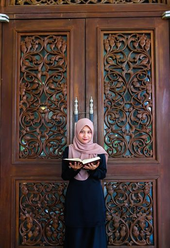 Open book. Portrait Beauty Young Women Women Beautiful Woman Standing Doorway Beautiful People Elégance Confidence  Hijab Front Door Traditional Culture Posing Traditional Clothing Ceremony Womenswear Closed Door Door Knocker Entryway Islam Religious Dress Doorknob Vanity Traditional Dancing Open Door Headscarf