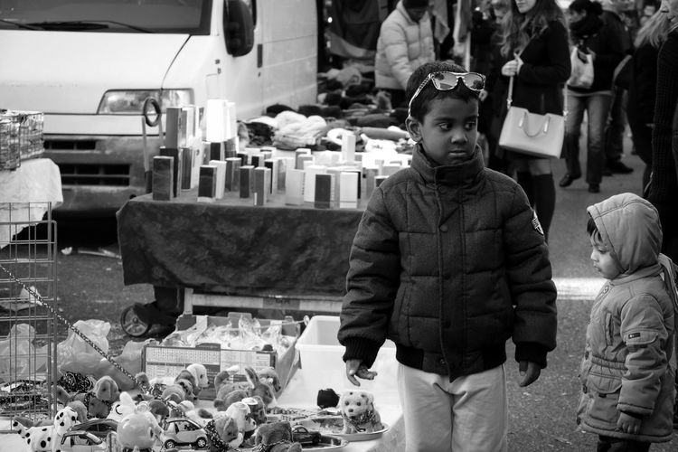 Portrait of boy standing in market