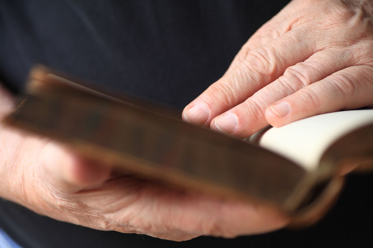 Book reader hands with copy space Adult Black Tshirt Book Close-up Closeup Copy Space Education Fingers Hands Holding Indoors  Indoors  Literature Men Natural Light One Person Pages Paper Reading A Book Real People Senior