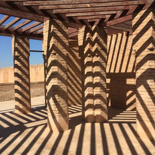 Shadow of metal structure on wall