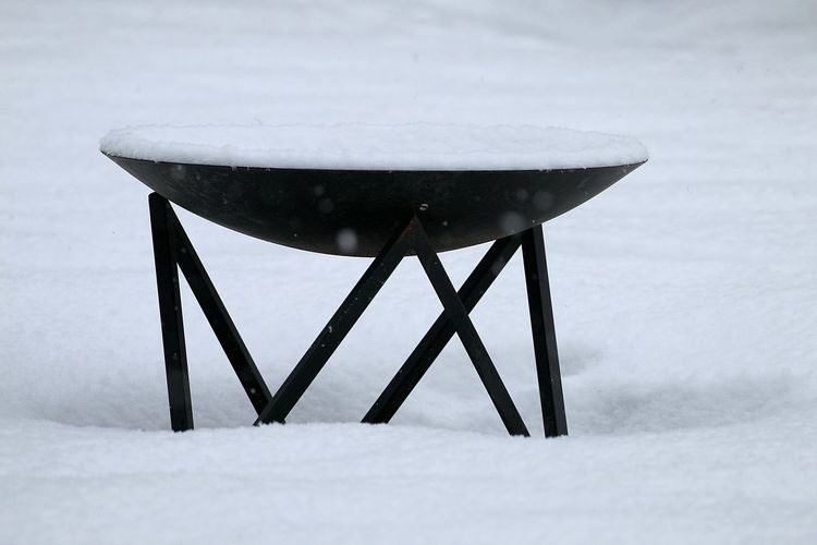 Close-up of snow covered table on field