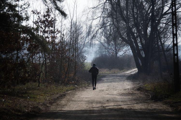 Woods Runner Running Outdoors Tree Full Length Road Men Walking Silhouette Rear View Sky Foggy Jogging Marathon Sprinting Men's Track