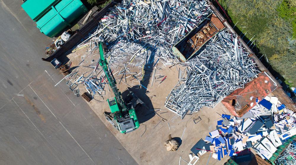Aerial photo of a crane with a huge claw in front a scrap heap, France Container Industrial Photography Industry Machinery Wood Working Aerial Photography Aerial View Cable Claw Claw Machine Crane Day Drone Photography Dump Engine Garbage Huge Material Recycled Materials Recycling Scrap Heap Scrap Metal Scrapyard Wood - Material