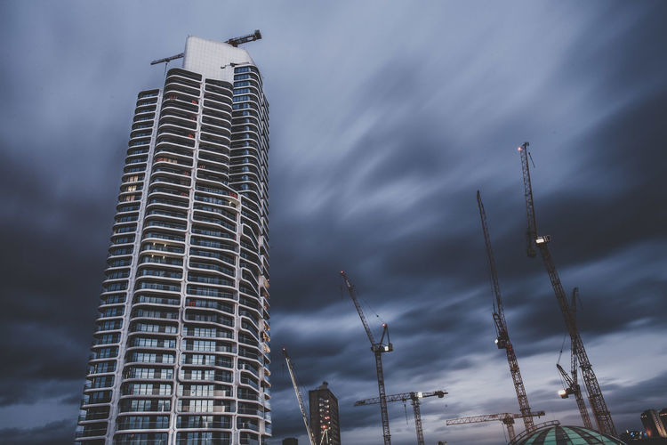 Low angle view of modern buildings against sky