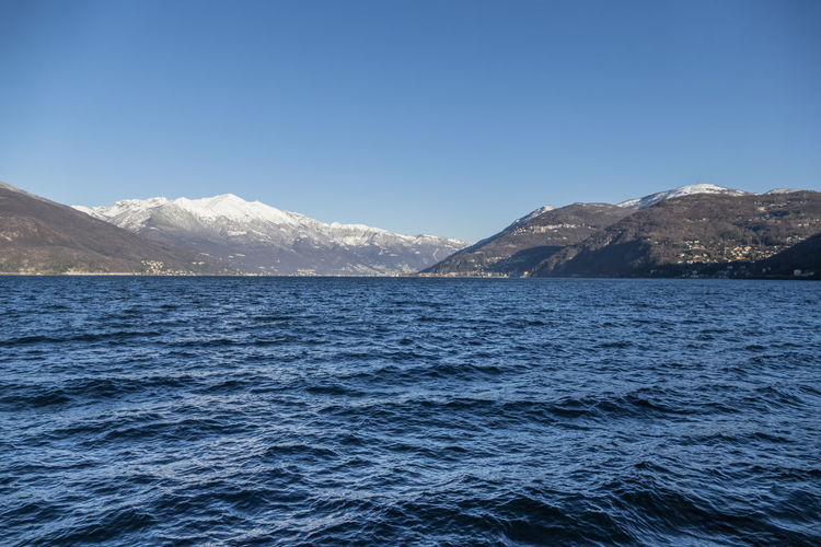Lake maggiore with the snow-capped mountains in the background