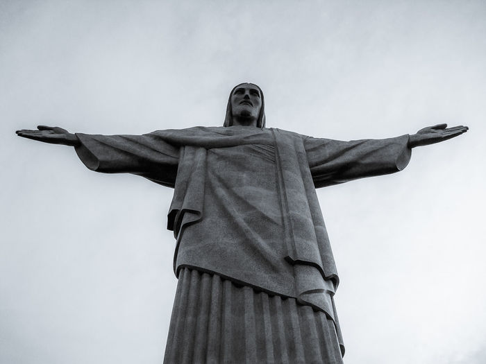 Low angle view of christ the redeemer against sky